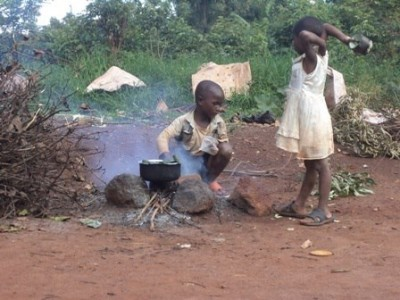 Photo of Children cooking over a fire